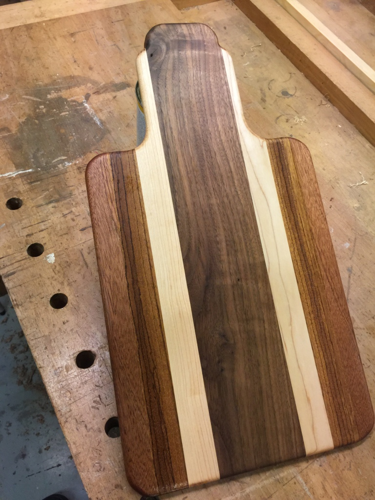 This student design an art deco look chopping board out of maple, ash, utile and zebrano